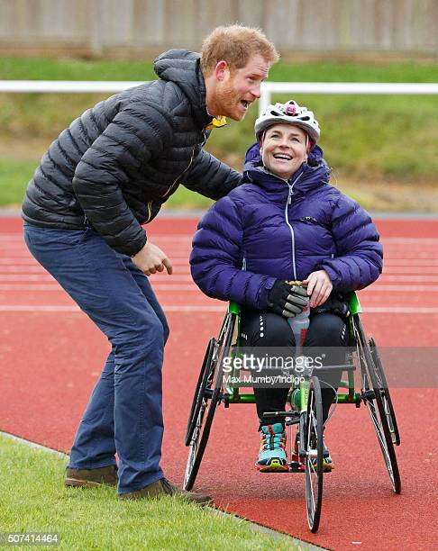 Prince Harry poses for a photograph with wheelchair athlete Anna Pollock as he attends the UK team trials for the Invictus Games Orlando 2016 at the...