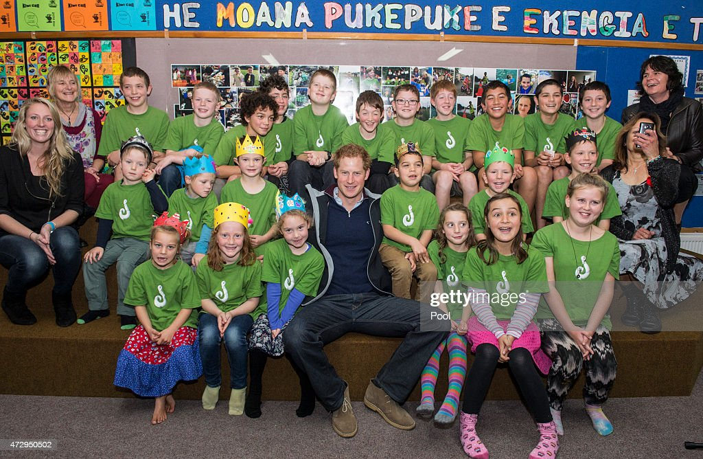 Prince Harry poses for a picture with pupils at Halfmoon Bay School in Oban as he leaves on May 11, 2015 in Stewart Island, New Zealand. Prince Harry is in New Zealand from May 9 through to May 16 attending events in Wellington, Invercargill, Stewart Island, Christchurch, Linton, Whanganui and Auckland.
