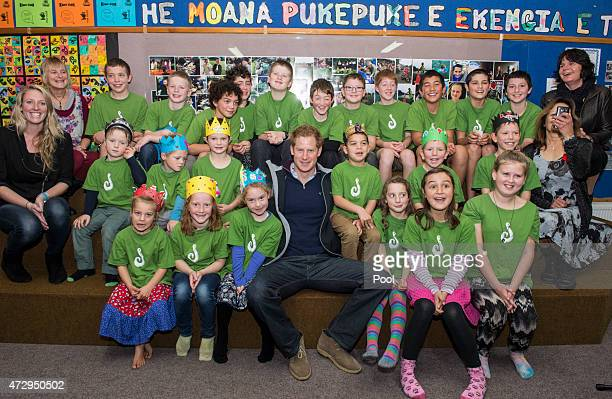 Prince Harry poses for a picture with pupils at Halfmoon Bay School in Oban as he leaves on May 11 2015 in Stewart Island New Zealand Prince Harry is...