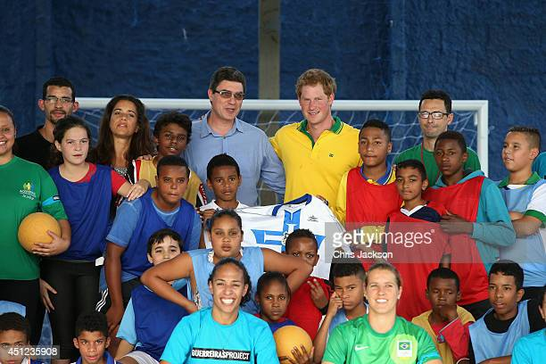 Prince Harry poses for a team picture after playing football as he visits the ACER Charity for disadvantaged children on June 25 2014 in Sao Paulo...
