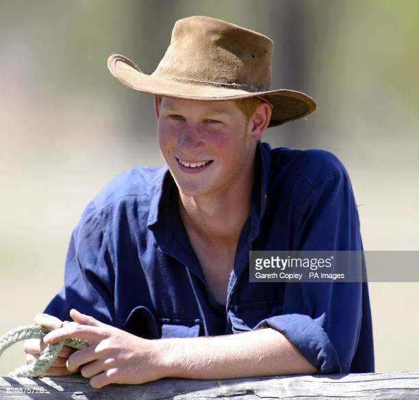 Prince Harry poses for photographers after riding his horse Guardsman with the team mustering herd bulls at Tooloombilla, Queensland, Australia,...