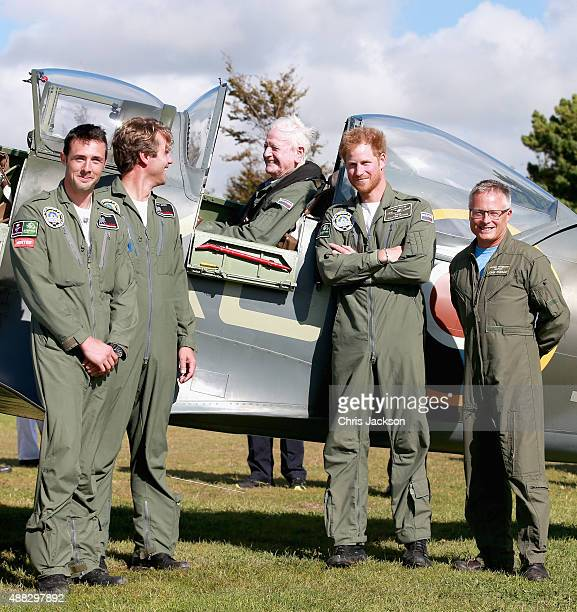 Prince Harry poses next to 95 year old Battle of Britain Veteran Tom Neil after he landed back at Goodwood Aerodrome in his Spitfire after a Battle...