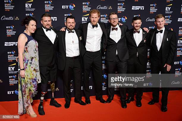 Prince Harry poses on the red carpet with Invictus team members at the BT Sport Industry Awards 2016 at Battersea Evolution on April 28 2016 in...