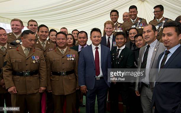Prince Harry poses with a group of Gurkhas at a reception ahead of the Gurkha 200 pageant in the grounds of the Royal Hospital Chelsea on June 9 2015...