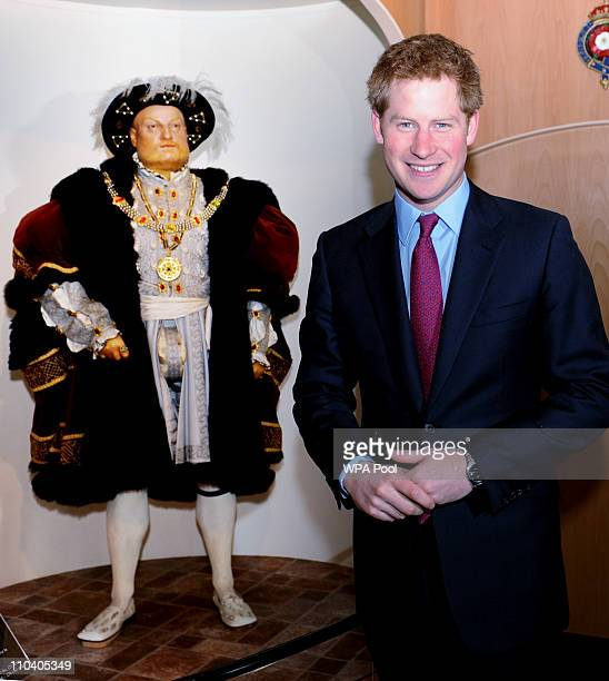 Prince Harry poses with a model of his ancestor Henry VIII during a visit to the Mary Rose Museum on March 18 2011 in Portsmouth United Kingdom...