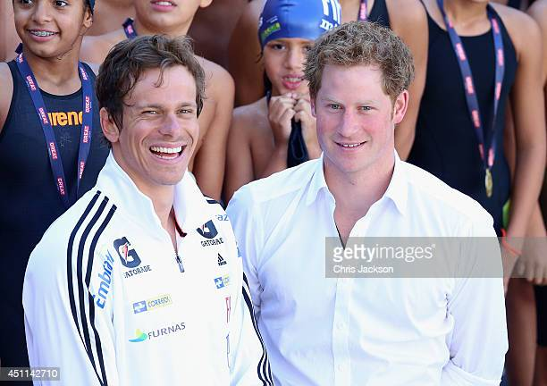 Prince Harry poses with Brazilian Olympic swimmer Cesar Cielo during a visit to Minas Tenis Clube supporting the UK's GREAT Campaign on June 24 2014...