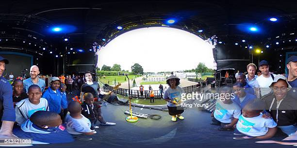 Prince Harry poses with Coldplay and the Sentebale Choir during the rehearsals for the Sentebale Concert at Kensington Palace on June 28 2016 in...