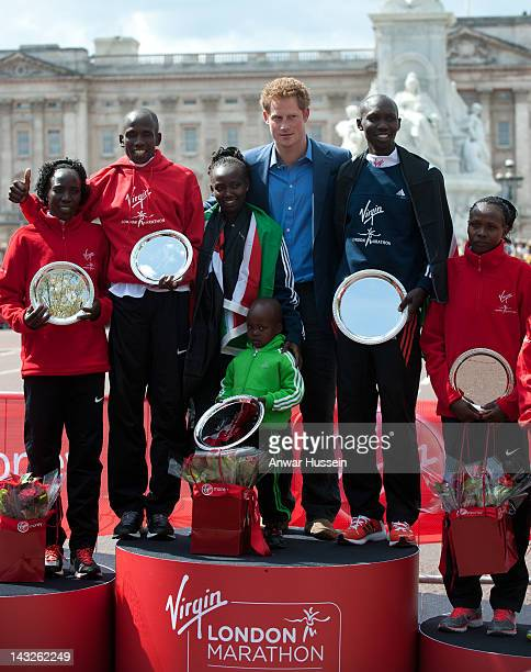 Prince Harry poses with Edna Kiplagat, Martin Lel, Mary Keitany, Wilson Kipsang and Priscah Jeptoo after presenting trophies at the Virgin London...