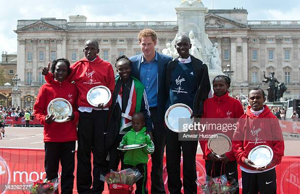 Prince Harry poses with Edna Kiplagat, Martin Lel, Mary Keitany, Wilson Kipsang, Priscah Jeptoo and Tsegaye Kebede after presenting trophies at the...
