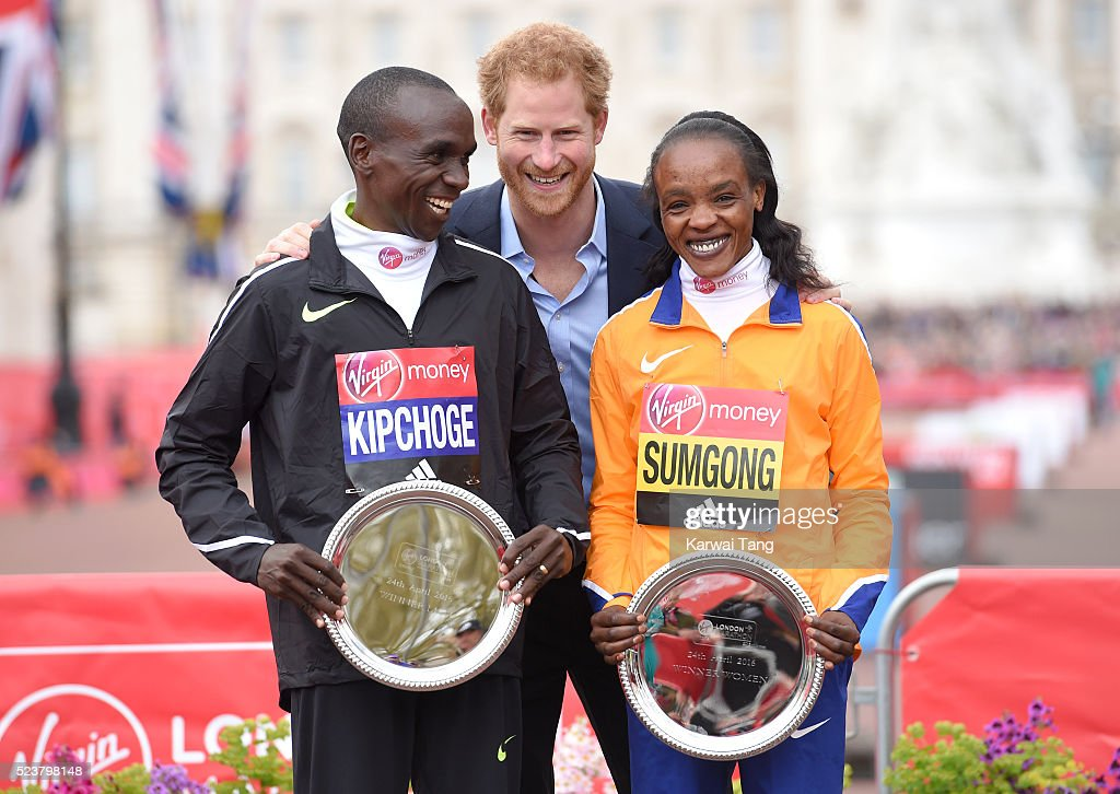Prince Harry poses with Eliud Kipchoge and Jemima Sumgong after they won the mens and womens races during the Virgin London Marathon 2016 on April 24, 2016 in London, England.