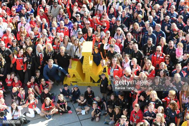 Prince Harry poses with friends and family of Invictus competitors on day 8 of the Invictus Games Toronto 2017 at Nathan Phillips Square on September...