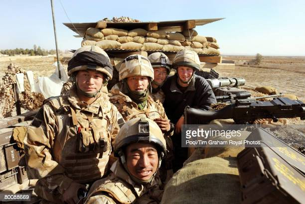 Prince Harry poses with Gurkha soldiers while at the observation post on JTAC Hill close to FOB Delhi on January 2 2008 in Helmand province Southern...
