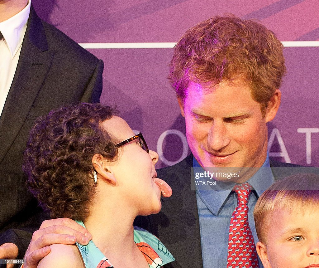 Prince Harry poses with inspirational child winner Rose Whittle at the WellChild Awards at the Intercontinental Hotel on September 3, 2012 in London, England.