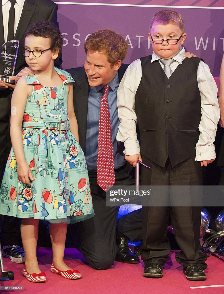 Prince Harry poses with inspirational child winners Rose Whittle and Matthew Merritt at the WellChild Awards at the Intercontinental Hotel on September 3, 2012 in London, England.