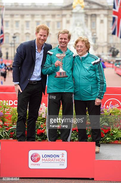 Prince Harry poses with lifetime achievement award winner Hugh Jones and Sylvia Disley widow of London Marathon founder John Disley at the Virgin...