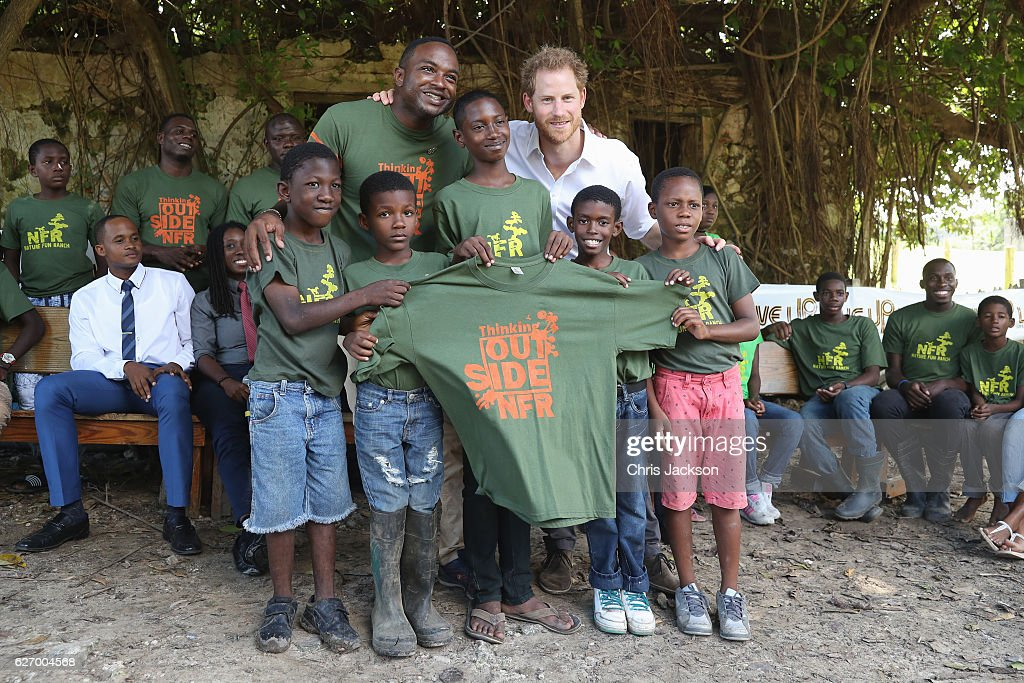 Prince Harry poses with volunteers at 'Nature Fun Ranch' on the eleventh day of an official visit on December 1, 2016 in St Andrew, Barbados. The ranch allows young people to speak freely with one another about important topics, including HIV/AIDS, providing them with a positive focus to guide their lives in the right direction. Prince Harry's visit to The Caribbean marks the 35th Anniversary of Independence in Antigua and Barbuda and the 50th Anniversary of Independence in Barbados and Guyana.