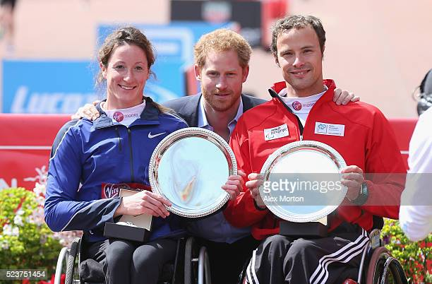 Prince Harry poses with Women's Wheelchair winner Tatanya Mcfadden of the United States and Men's Wheelchair winner Marcel Hug of Switzerland during...