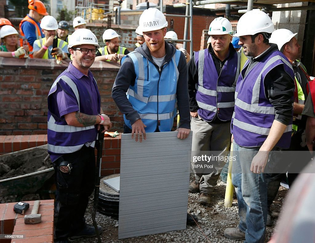 Prince Harry prepares to lay some paving slabs as he helps to renovate homes for ex-service personnel as part of the BBC television DIY SOS series on September 23, 2015 in Manchester, England. Prince William and Prince Harry visited Manchester on Wednesday where they helped to renovate homes for ex-service personnel as part of the BBC television DIY SOS series.