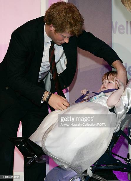 Prince Harry presents 4 year old Katie Ellen Jones winner of the WellChild Best Brave Child age 45 Award with a 30th anniversary commemorative medal...