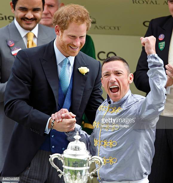 Prince Harry presents Frankie Dettori with his prize for wining the St James's Palace stakes on day 1 of Royal Ascot at Ascot Racecourse on June 14...