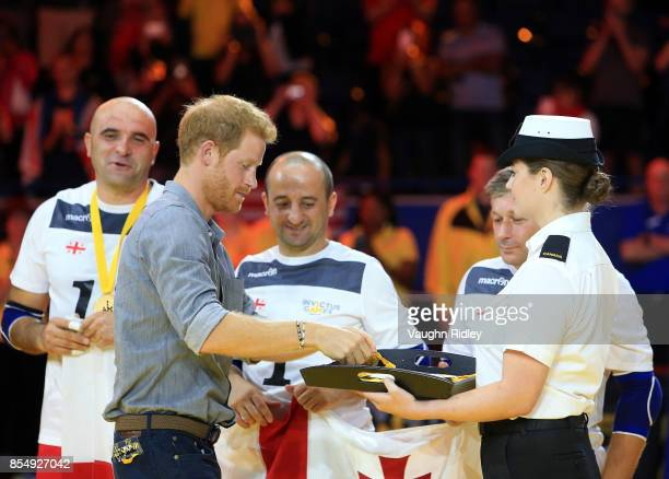 Prince Harry presents Gold Medals to members of Team Georgia following the Sitting Volleyball Finals during the Invictus Games 2017 at Mattamy...
