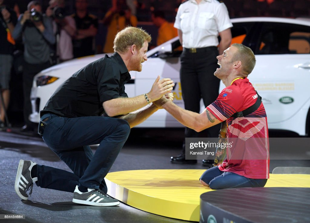 Prince Harry presents Mark Ormrod with his medal during the Rowing at the Invictus Games Toronto 2017 at the Mattamy Athletic Centre on September 26, 2017 in Toronto, Canada. The Games use the power of sport to inspire recovery, support rehabilitation and generate a wider understanding and respect for the Armed Forces.