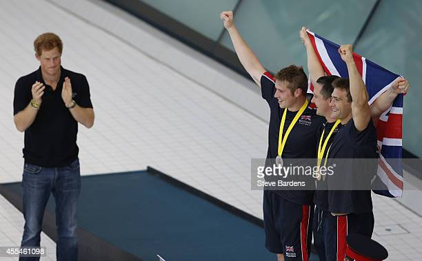 Prince Harry presents medals to competitors at the Invictus Games swimming at the London Aquatics Centre at Olympic Park on September 14, 2014 in...
