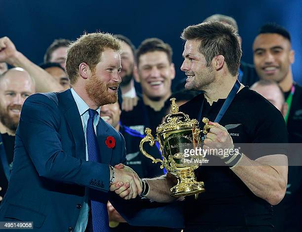 Prince Harry presents Richie McCaw of New Zealand with the Webb Ellis Cup after the 2015 Rugby World Cup Final match between New Zealand and...