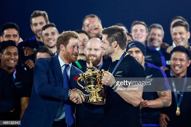 Prince Harry presents Richie McCaw of New Zealand with the Webb Ellis Cup following the 2015 Rugby World Cup Final match between New Zealand and...