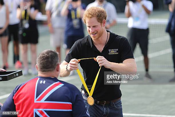 Prince Harry presents the Gold Medal to members of the United Kingdom during the Invictus Games Orlando 2016 Wheelchair Tennis Finals at the ESPN...
