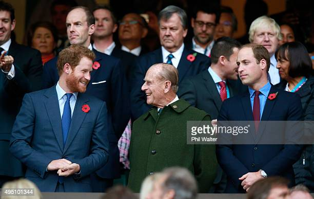 Prince Harry, Prince Phillip and Prince William enjoy the atmosphere during the 2015 Rugby World Cup Final match between New Zealand and Australia at...