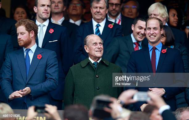 Prince Harry, Prince Phillip and Prince William enjoy the build up to the 2015 Rugby World Cup Final match between New Zealand and Australia at...