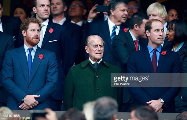 Prince Harry, Prince Phillip and Prince William stand for the national anthems at to the 2015 Rugby World Cup Final match between New Zealand and...
