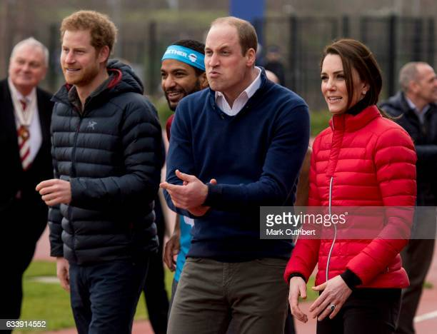 Prince Harry Prince William Duke of Cambridge and Catherine Duchess of Cambridge cheer on runners during a training day for the Heads Together team...