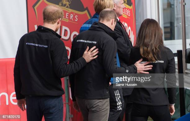 Prince Harry, Prince William, Duke of Cambridge and Catherine, Duchess of Cambridge walk off together after starting the 2017 Virgin Money London...