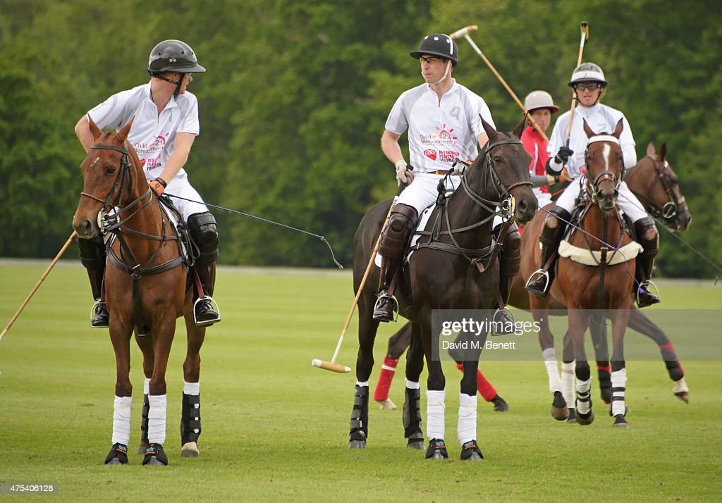 Prince Harry, Prince William, Duke of Cambridge, and Mark Tomlinson play during day two of the Audi Polo Challenge at Coworth Park on May 31, 2015 in London, England.