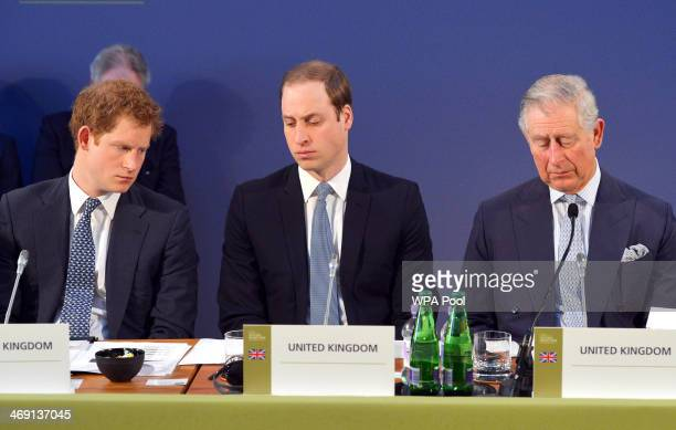 Prince Harry Prince William Duke of Cambridge and Prince Charles Prince of Wales listen to speeches by foreign leaders at the Illegal Wildlife Trade...