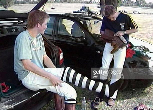 Prince Harry pulls on his socks as he and his older brother Prince Wiliam prepare to play polo in this ITN pooled video released 20 June to mark...
