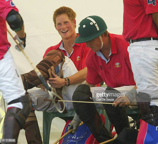 Prince Harry puts his polo kit on during polo at the Guards Polo Club in the Cartier Golden Jubilee Polo Match against Hurlingham July 125th 2004 in...