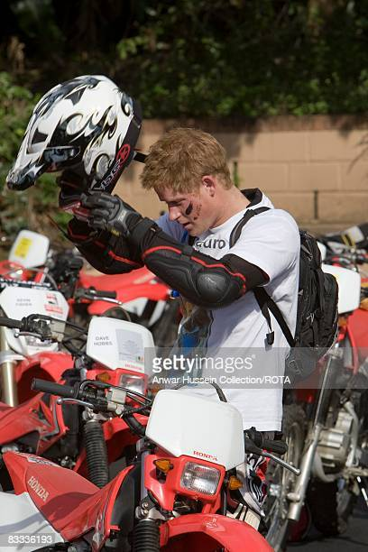 Prince Harry puts on his helmet at the start of the Enduro 2008 Motorcycle Rally to benefit UNICEF the Nelson Mandela Children's Fund and Sentebale a...