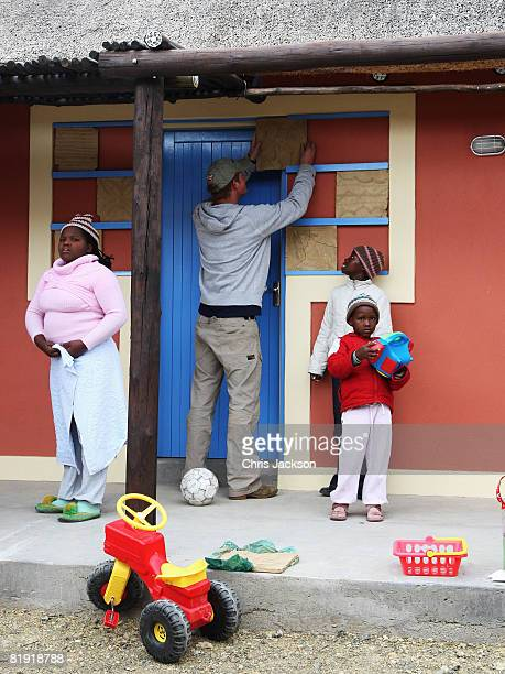 Prince Harry puts up a special tile he designed at LCCU on July 9, 2008 in Maseru, Lesotho. Prince Harry and 26 soldiers from the Household Cavalry...