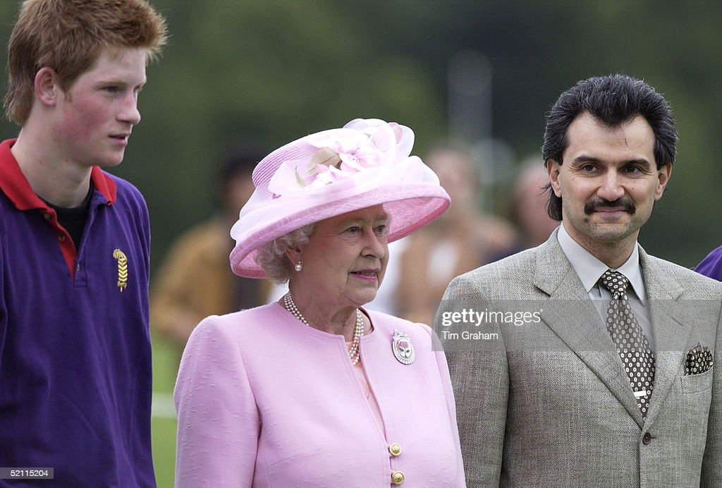 Prince Harry And Queen And Waleed : News Photo