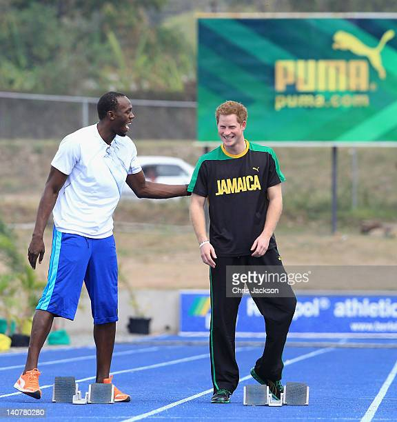 Prince Harry races Usain Bolt at the Usain Bolt Track at the University of the West Indies on March 6 2012 in Kingston Jamaica Prince Harry is in...