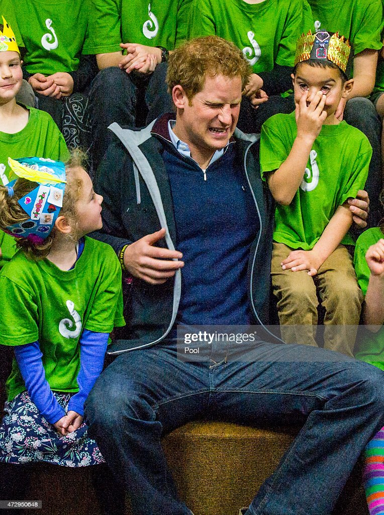Prince Harry reacts as he meets pupils at Halfmoon Bay School in Oban as he leaves on May 11, 2015 in Stewart Island, New Zealand. Prince Harry is in New Zealand from May 9 through to May 16 attending events in Wellington, Invercargill, Stewart Island, Christchurch, Linton, Whanganui and Auckland.