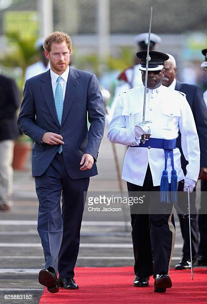 Prince Harry reviews a guard of honour on the seventh day of an official visit to the Caribbean on November 26 2016 in Kingstown Saint Vincent and...
