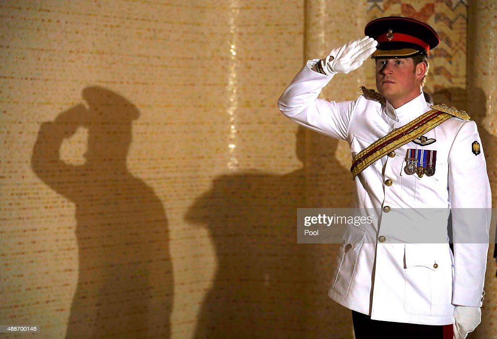 Prince Harry salutes after laying a wreath at the Tomb of the Unknown Soldier at the Australian War Memorial on April 6, 2015 in Canberra, Australia. Prince Harry, or Captain Wales as he is known in the British Army, will end his military career with a month long secondment to the Australian Defence Force in barracks in Sydney, Perth and Darwin.