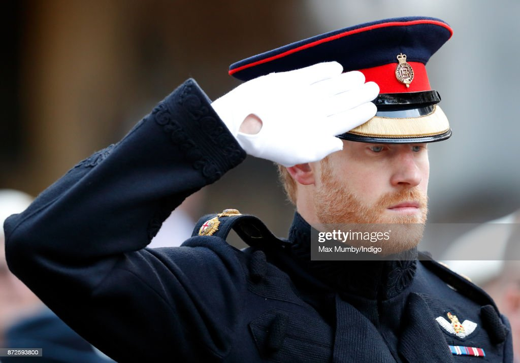 Prince Harry salutes as he visits the Field of Remembrance at Westminster Abbey on November 9, 2017 in London, England. The first Field of Remembrance was held in the grounds of Westminster Abbey in November 1928 when only two Remembrance Tribute Crosses were planted, but has now grown to approximately 70,000 crosses planted.