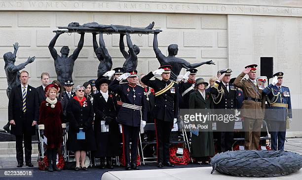 Prince Harry salutes as joins others to attend The Armistice Day Service at The National Memorial Arboretum on November 11 2016 in Stafford England...