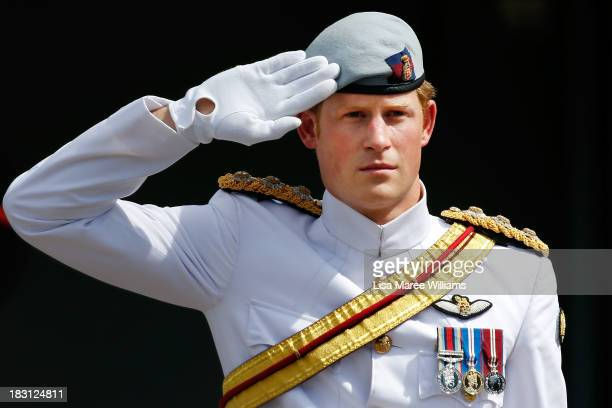 Prince Harry salutes members of the Royal Australian Navy prior to boarding the Leeuwin on October 5 2013 in Sydney Australia Over 50 ships...