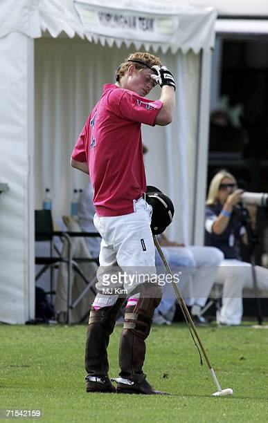 Prince Harry seen during The Cartier Cup between Prince of Wales' Team and Hurlingham Team at the Guards Polo Club on July 30 2006 in Egham England